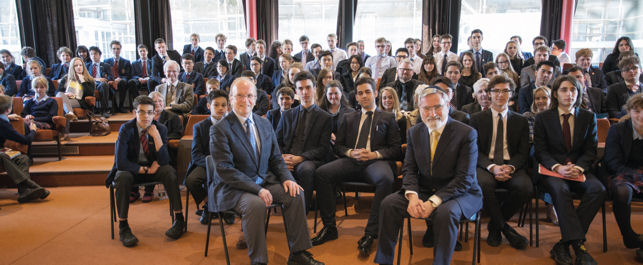 Rabbi Lord Jonathan Sacks with Eric Priest and schoolchildren